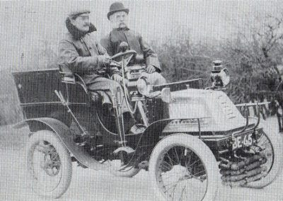 R.I.Swaby is the passenger in one of the first motor cars to visit Scunthorpe. The driver is Mr. Hanley